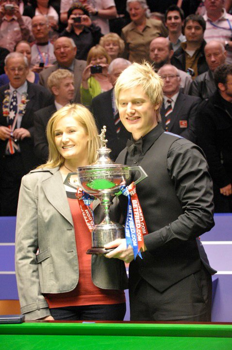 Neil Robertson posing for photographs with the World Championship trophy and his mother Alison